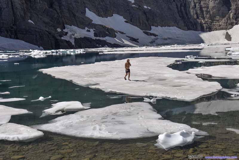 Man Standing on Iceberg