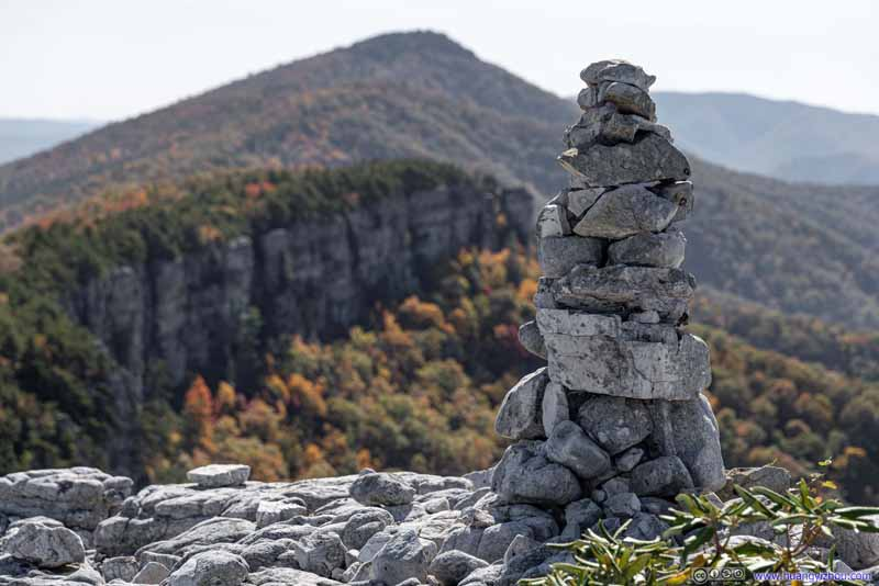 Cairn and Distant Cliff