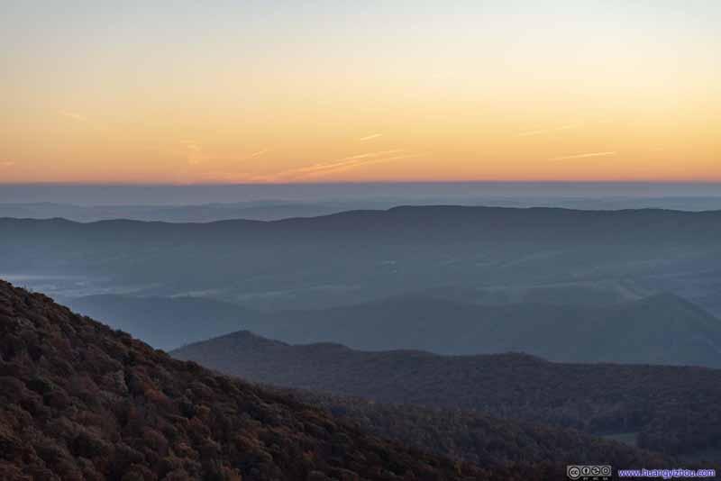 Sunrise Glow over Distant Horizon